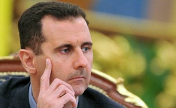Assad rejects exile, says will 'live and die in Syria'