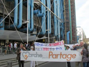 Parisians march to promote the virtue of sharing