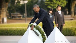 Obama in Hiroshima paints a Peace Sign on a bomb