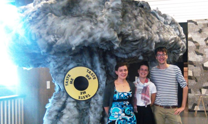 Emma Pritchard, Marie... and Lukas... in front of an Atomic bomb sculpture exhibited at the conference.