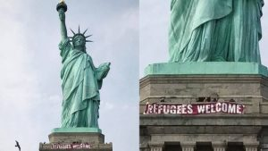 "Activists Unfurl ""Refugees Welcome"" Banner on Statue of Liberty"