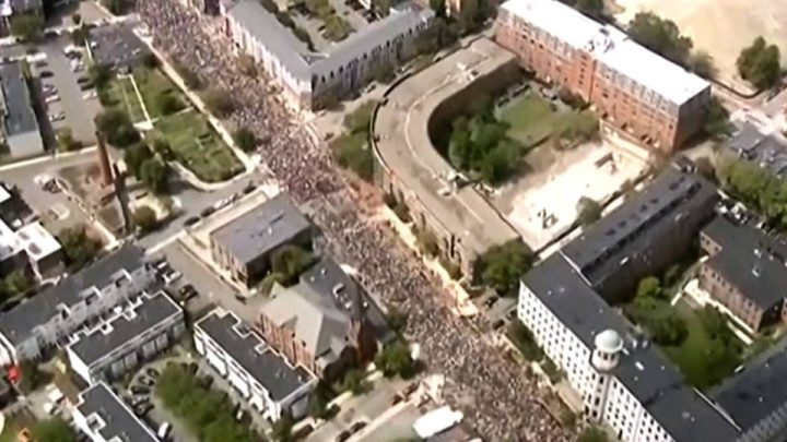 Tens of Thousands March Against White Supremacy in Boston & Other U.S. Cities