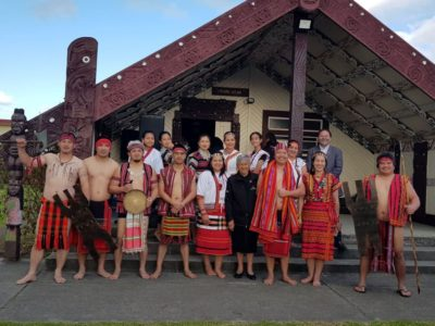 Clad in their traditional costumes, migrant Igorots in New Zealand pose with the Tauranga representatives who welcomed them on the Marae (Maori meeting ground fronting a Te Wharenui, carved building) during the first of its kind inaugural ceremony where the Igorots experienced the Maori custom of manaakitanga (hospitality). Photo Credit: Eugene Banotan.